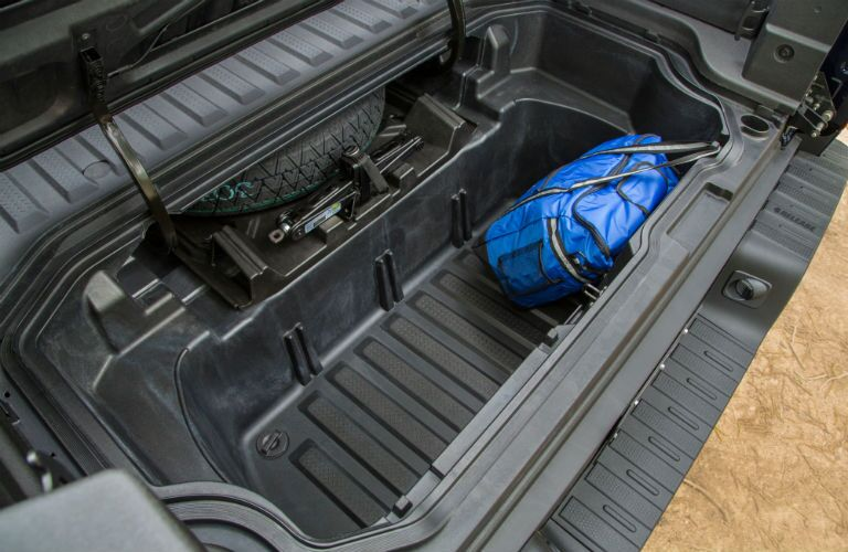 A photo of the lockable storage compartment in the cargo bed of the 2019 Honda Ridgeline.
