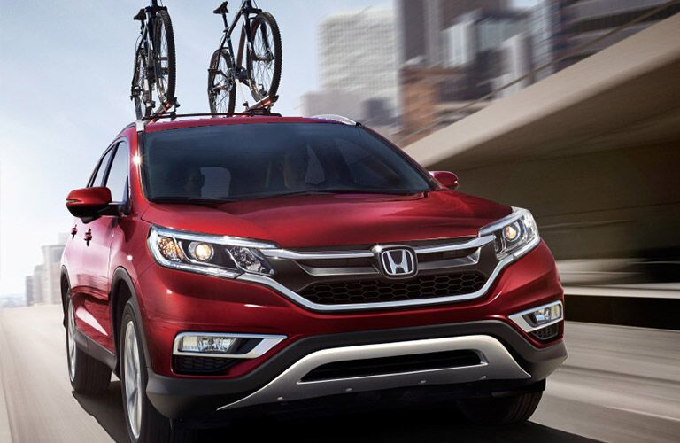 Honda CR-V Front End View in Red with Bicycles on the Bike Rack