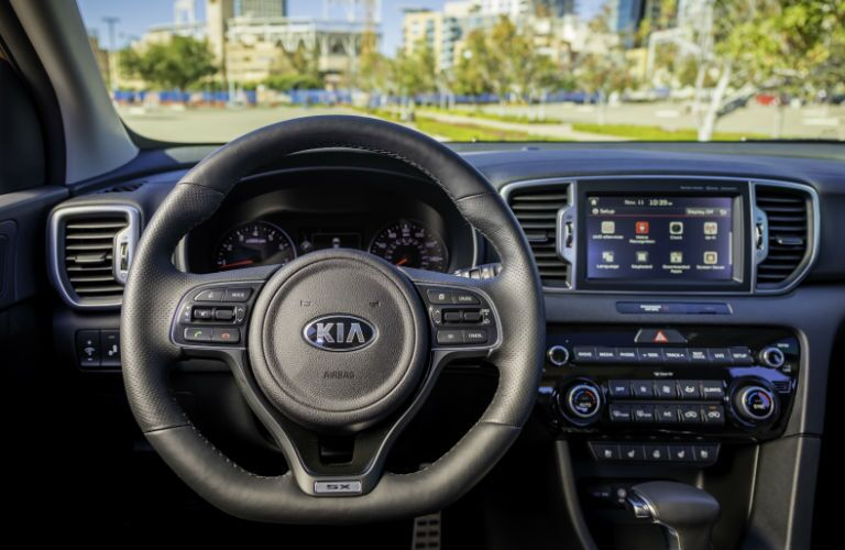 2018 Kia Sportage steering wheel and dashboard