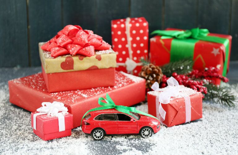 Gifts surrounding a small toy car