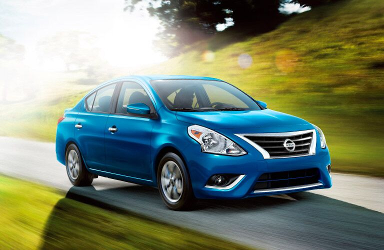 front view of 2016 nissan versa with boomerange headlights