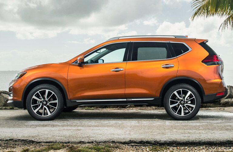 side view of orange nissan rogue