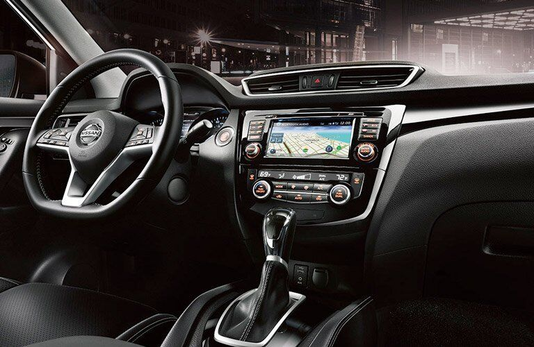 2017 Nissan Rogue Sport interior steering wheel and navigation screen