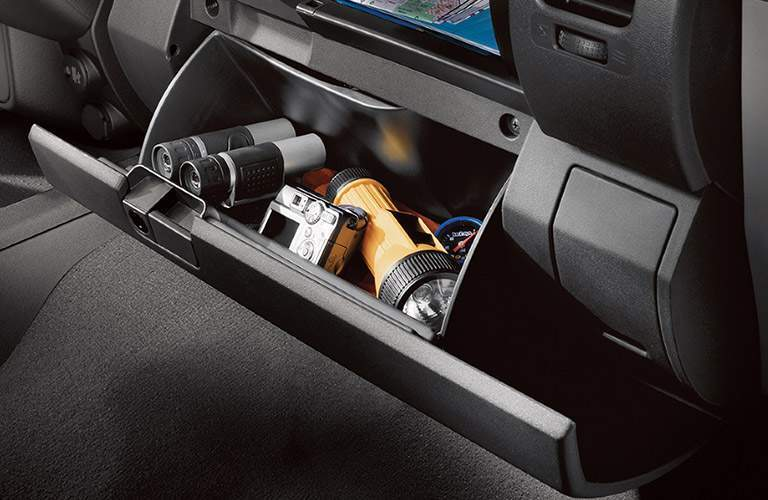 2018 Nissan Frontier glovebox with binoculars and flashlight