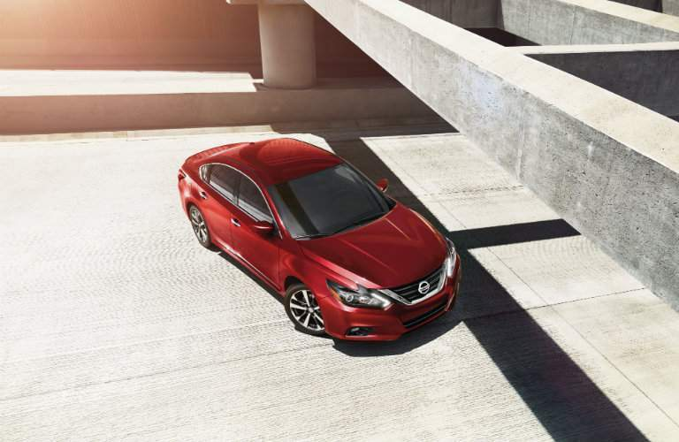 2018 Nissan Altima red color parked under gray concrete structure