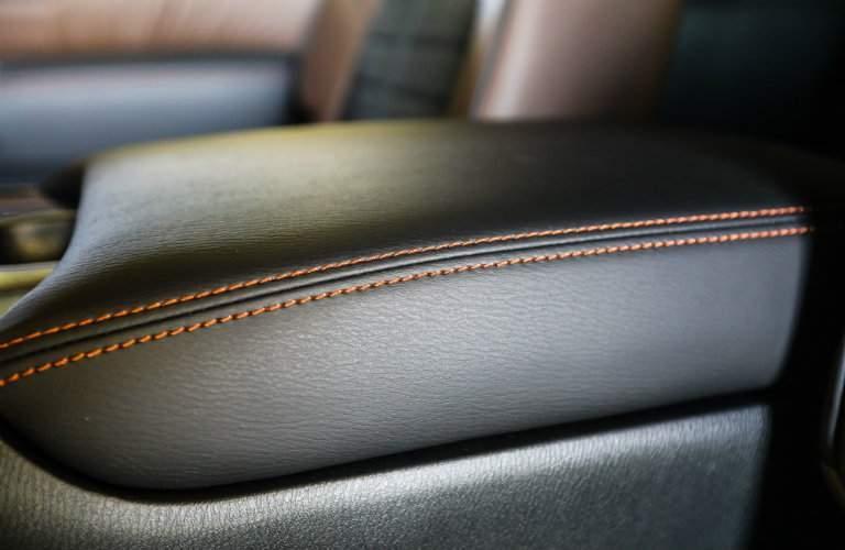 2018 Nissan Armada Platinum Reserve Center Armrest leather contrast stitching