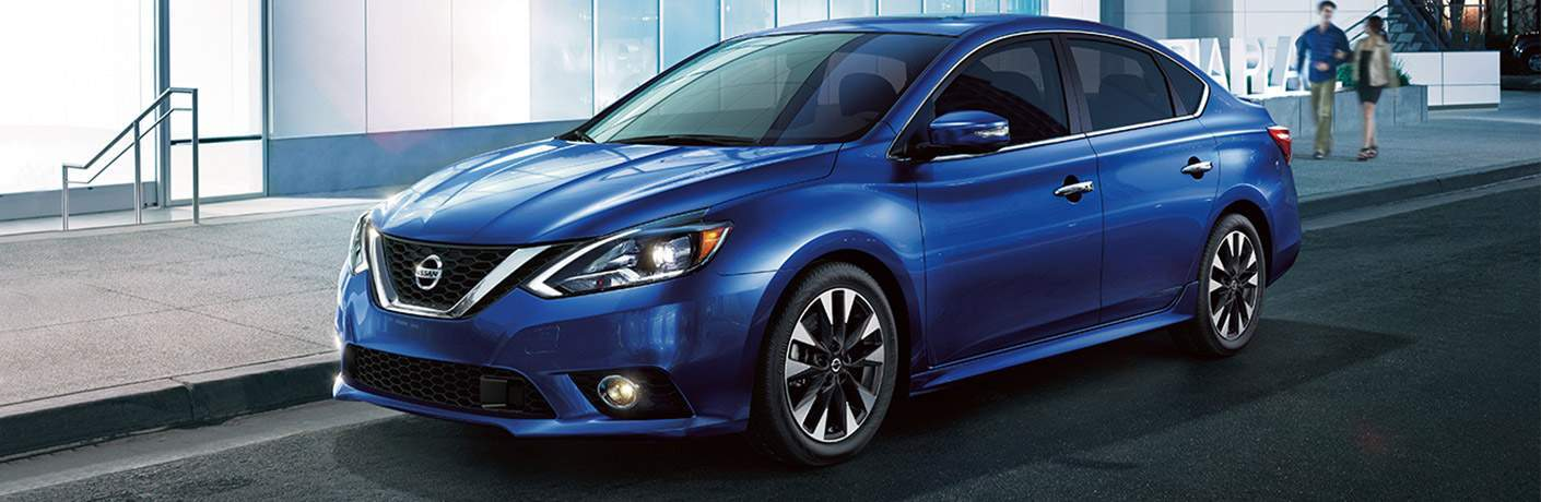 Blue 2018 Nissan Sentra parked by stairs