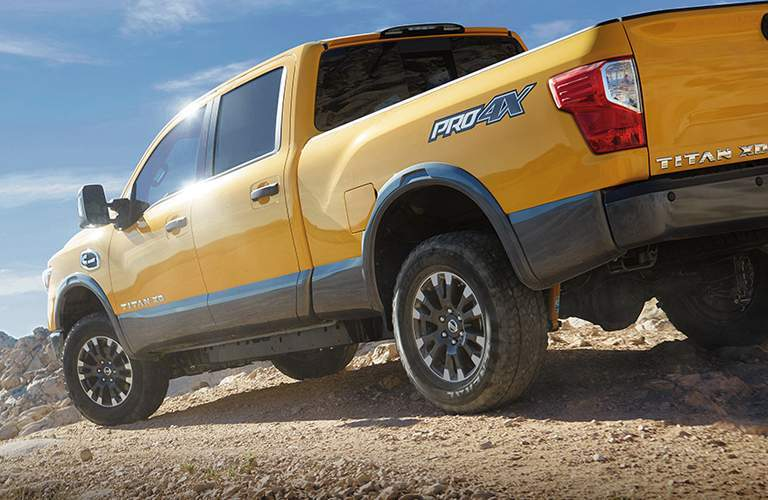 Rear 3/4 picture of the 2018 Nissan Titan XD in yellow