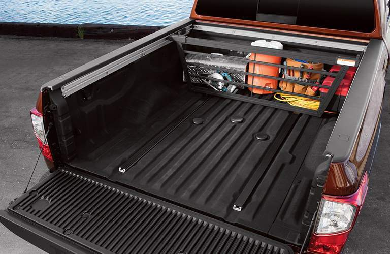 Bed of the 2018 Nissan Titan XD with crate full of tools