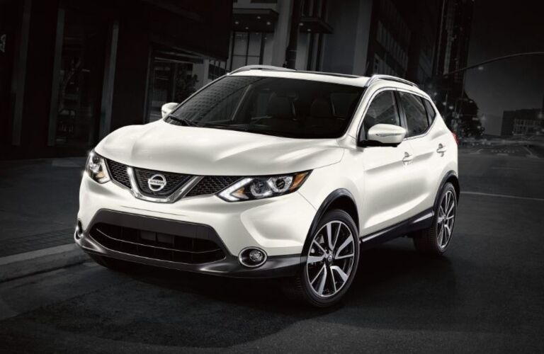 White 2018.5 Nissan Rogue Sport on a black background