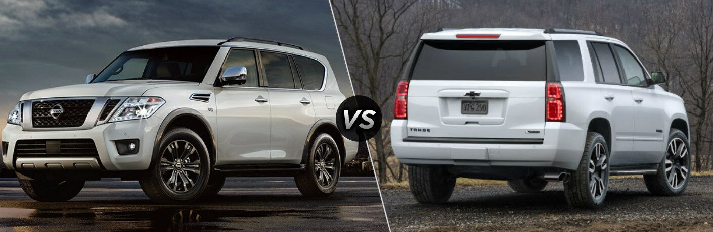 Silver 2018 Nissan Armada and white 2018 Chevy Tahoe side by side