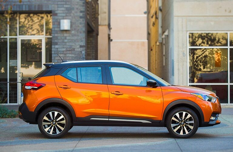 Side view of an orange 2018 Nissan Kicks