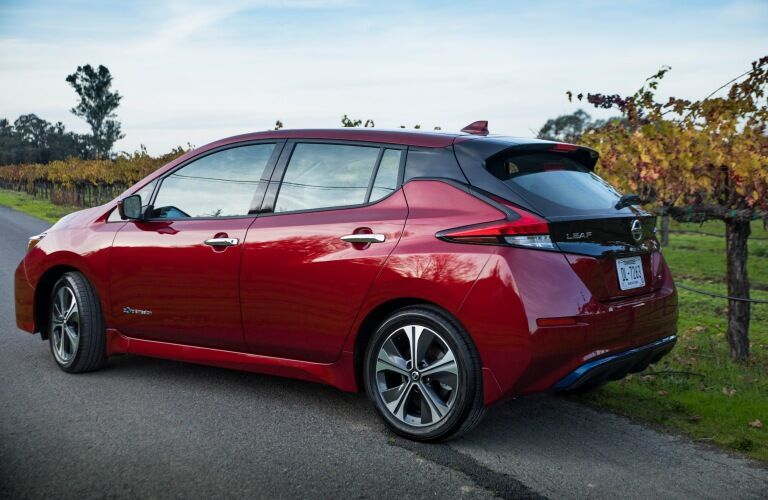 Red 2019 Nissan LEAF charging outside