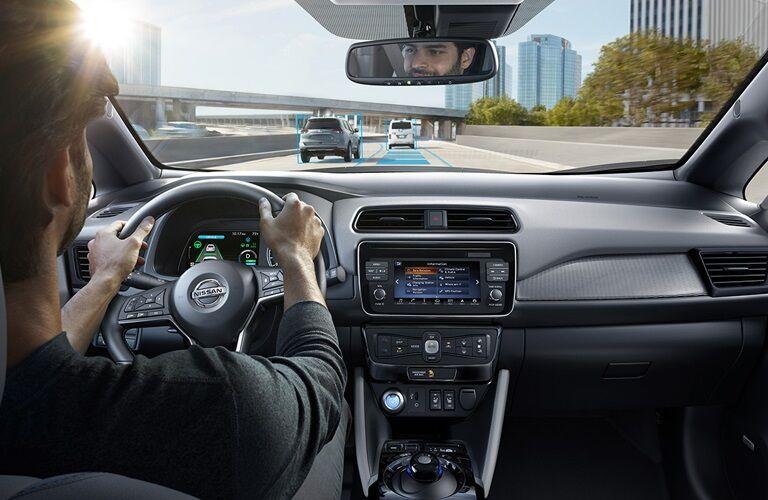 Man driving 2018 Nissan LEAF on highway