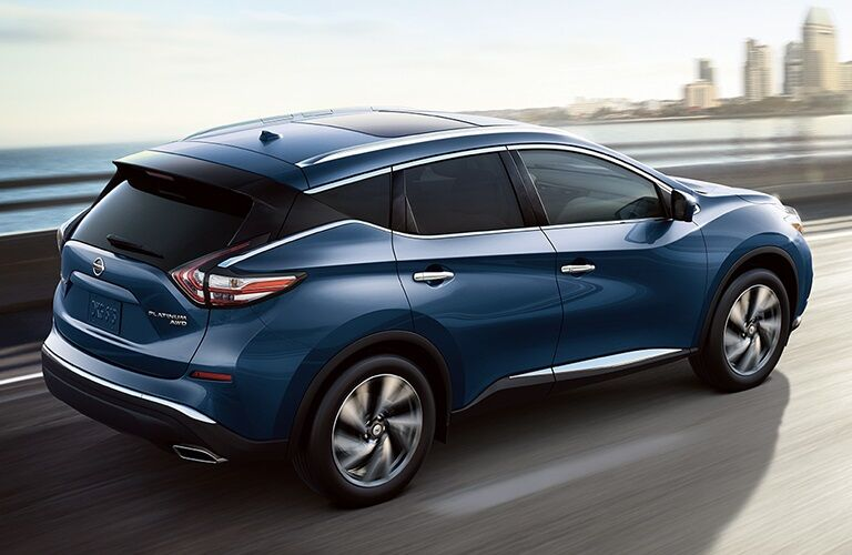 Blue 2018 Nissan Murano driving over bridge