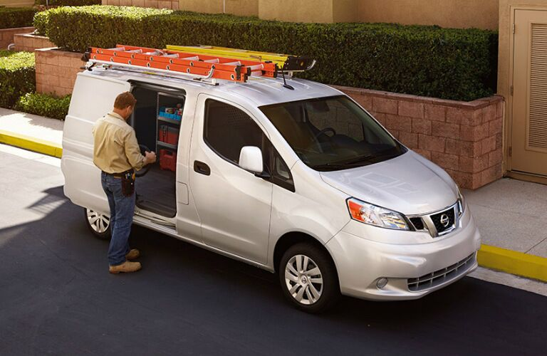 Man getting tools from his 2018 Nissan NV200 Compact Cargo van