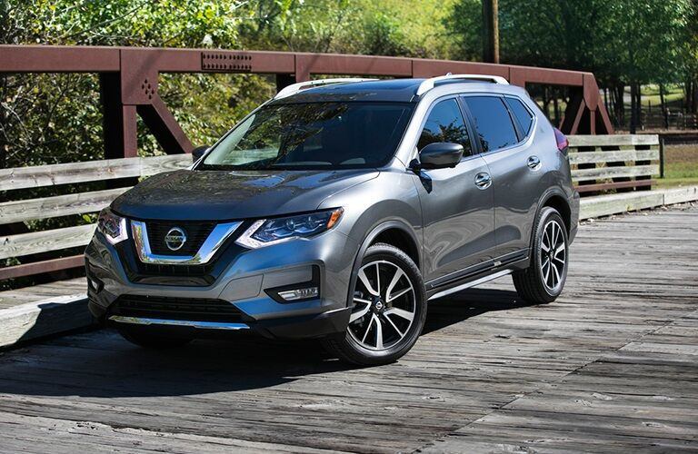 Gray 2018 Nissan Rogue parked on bridge