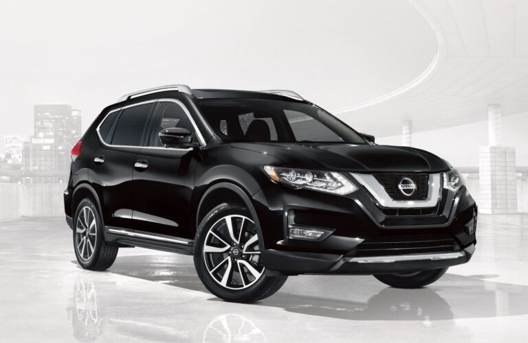 Side view of a black 2018 Nissan Rogue
