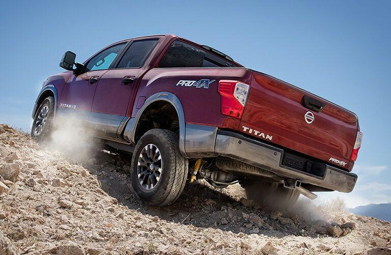 2018 Nissan TITAN driving up rocky hill