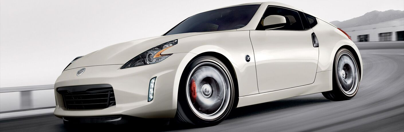 white nissan 370z coupe on a racetrack