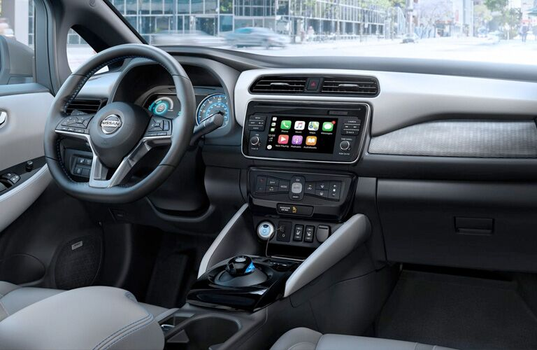 Front interior of the 2019 Nissan LEAF, with Apple CarPlay on the center console screen.