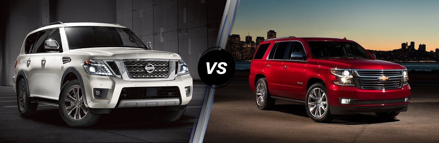 White 2019 Nissan Armada and red 2019 Chevrolet Tahoe side by side