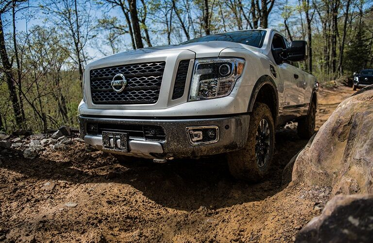 Silver 2019 Nissan TITAN XD driving off-road