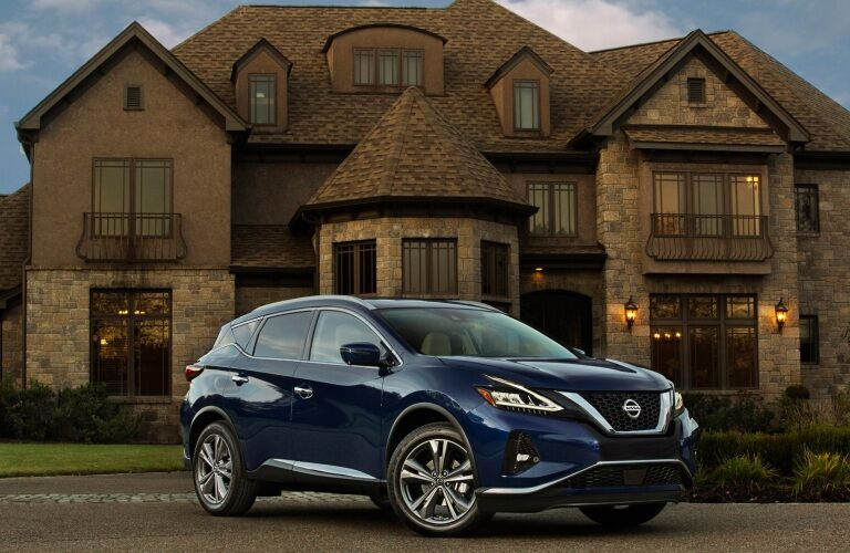 Blue 2019 Nissan Murano in front of house