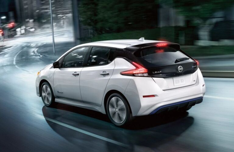 White 2019 Nissan LEAF driving at night