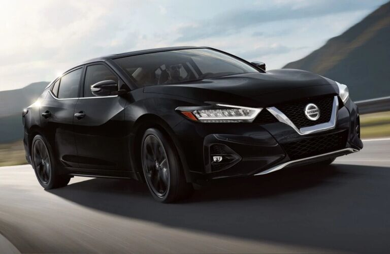 Black 2019 Nissan Maxima driving on open road