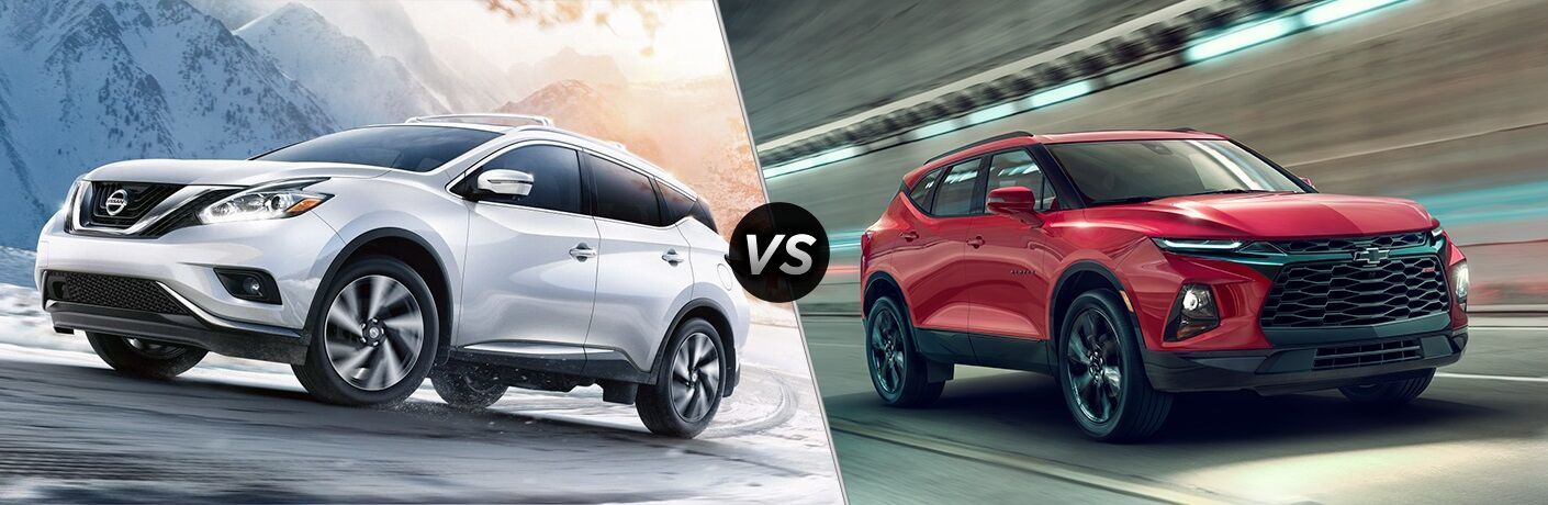 White 2019 Nissan Murano and red 2019 Chevy Blazer side by side