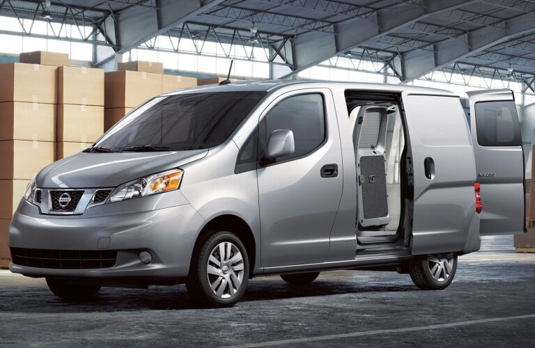 Silver 2019 Nissan NV200 in a warehouse