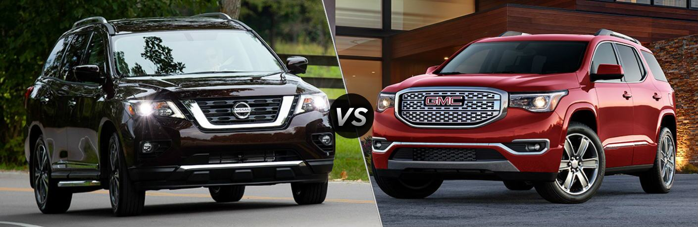 Black 2019 Nissan Pathfinder and red 2019 GMC Acadia side by side