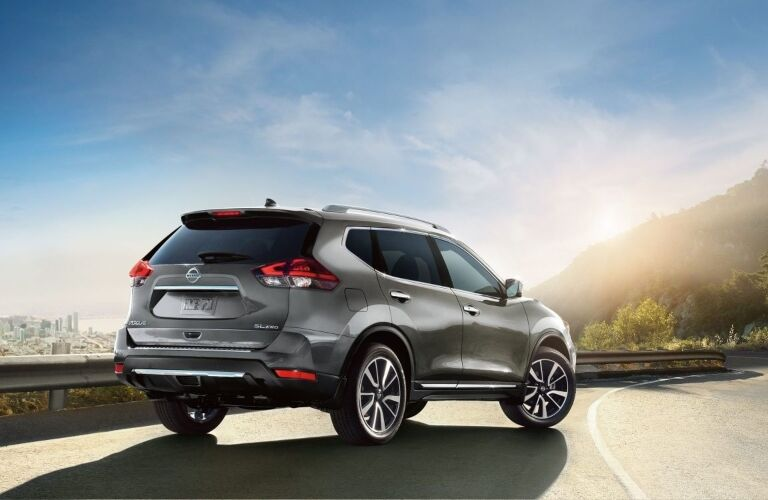 Silver 2019 Nissan Rogue parked on cliffside road