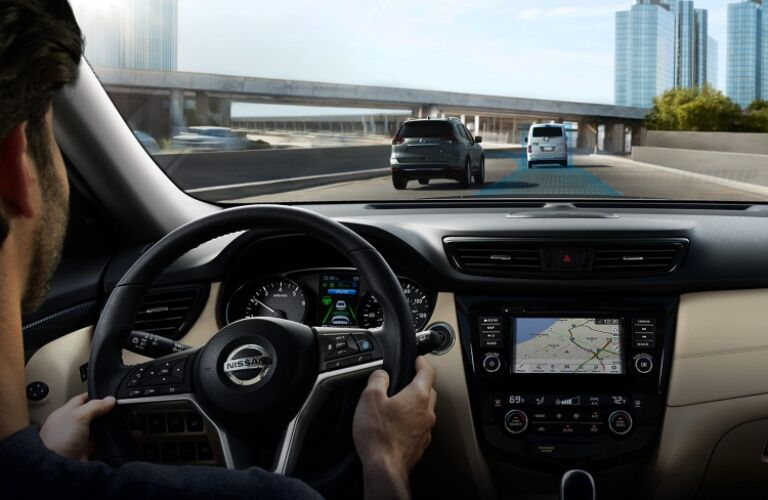 Man behind the wheel of a 2019 Nissan Rogue