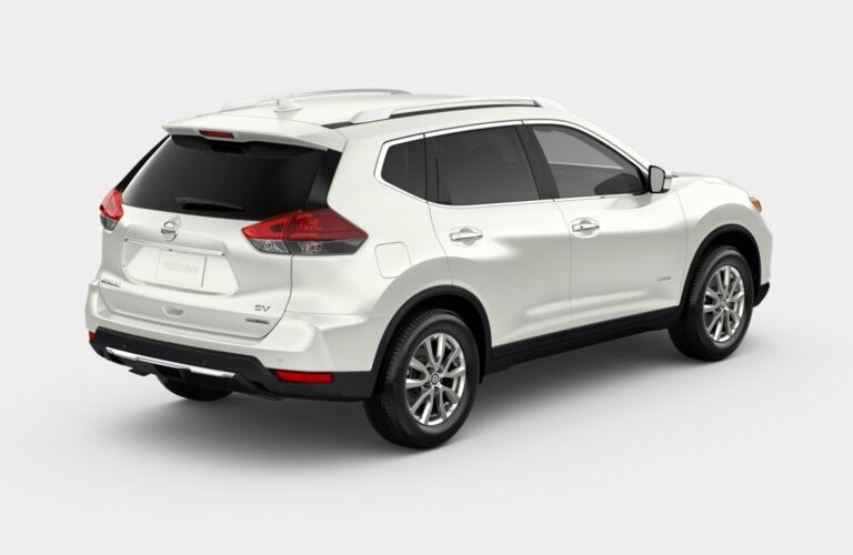 Rear side view of a white 2019 Nissan Rogue SV Hybrid