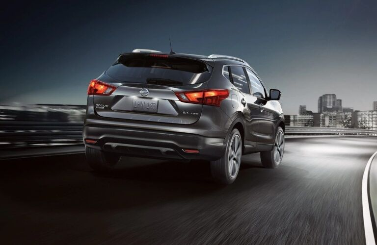 Rear view of a gray 2019 Nissan Rogue Sport on the highway