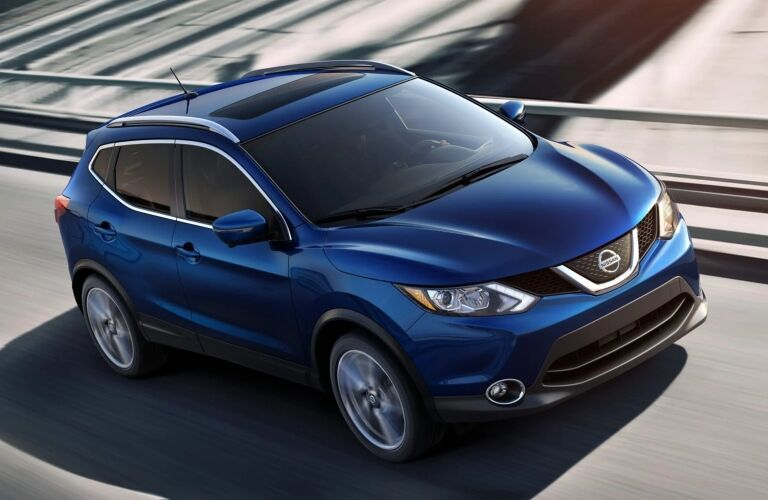 Blue 2019 Nissan Rogue Sport on the highway