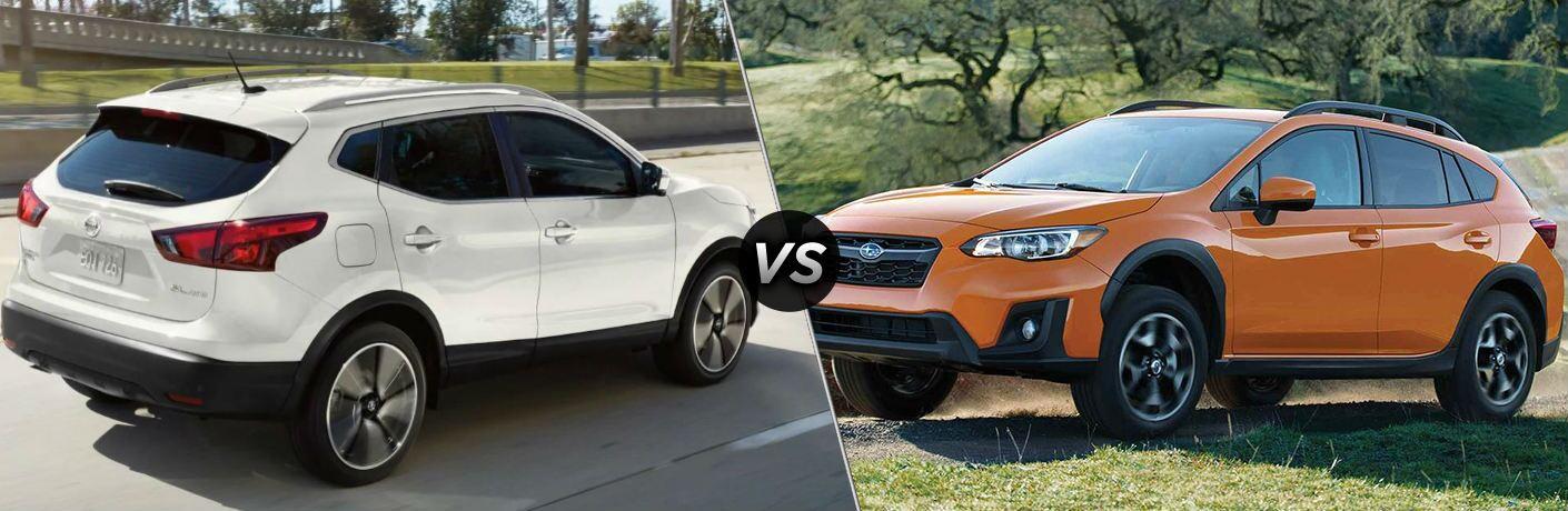 White 2019 Nissan Rogue Sport and orange 2019 Subaru Crosstrek side by side