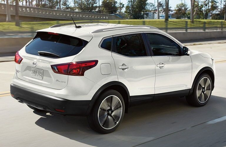 Rear side view of a white 2019 Nissan Rogue Sport