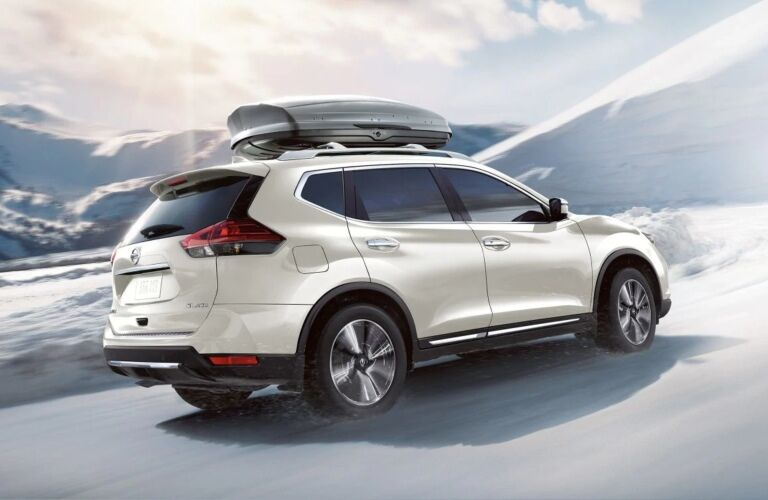 White 2019 Nissan Rogue driving through snow