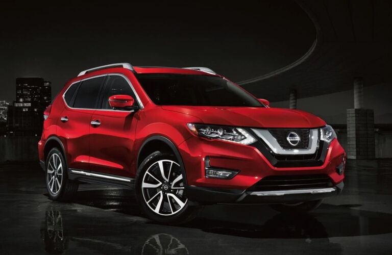 Red 2019 Nissan Rogue on black background