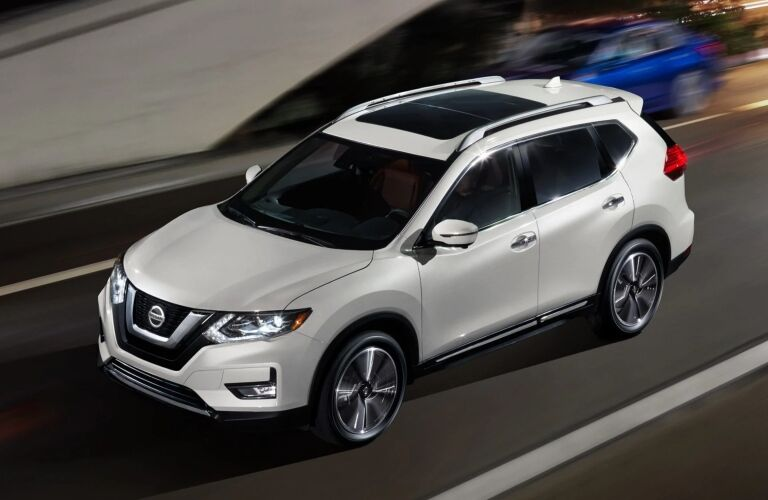 White 2019 Nissan Rogue driving in traffic