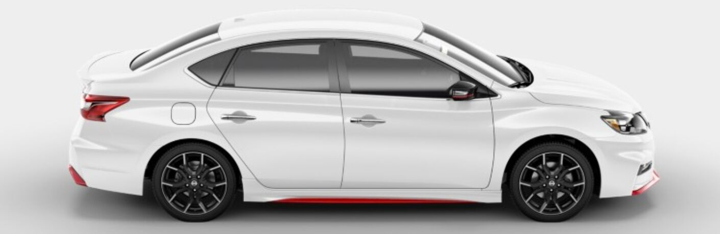 Right side view of a white 2019 Nissan Sentra NISMO