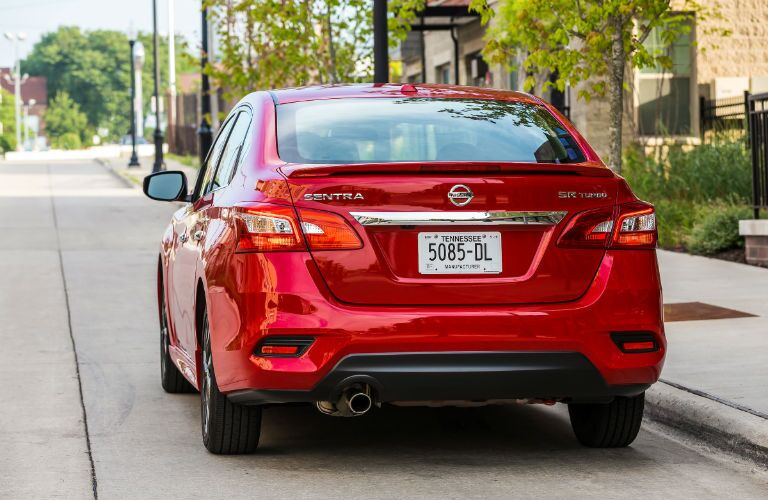 2019 Nissan Sentra parked by a curb with rear end view