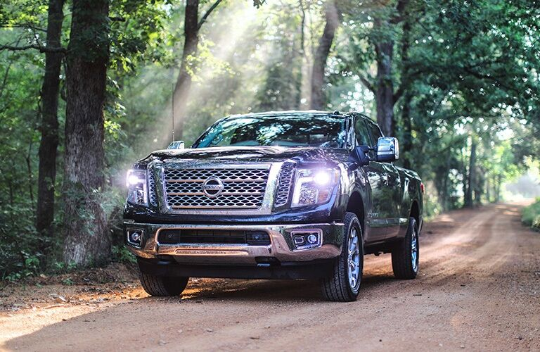 2019 Nissan TITAN XD driving through forest trail