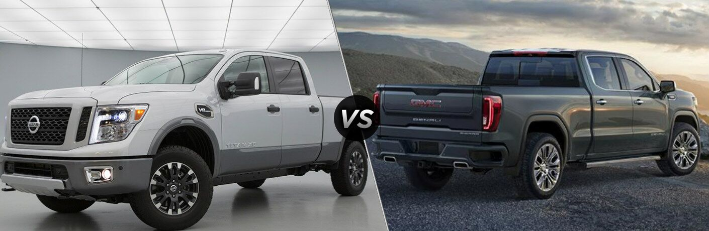 White 2019 Nissan TITAN and gray 2019 GMC Sierra side by side