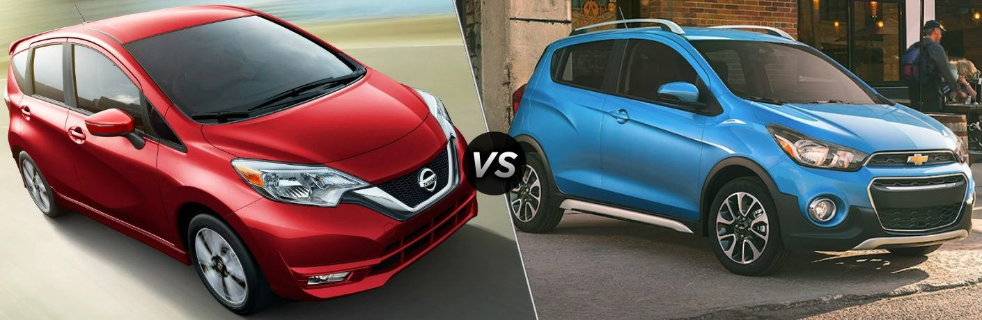 Red 2019 Nissan Versa Note and blue 2019 Chevy Spark side by side