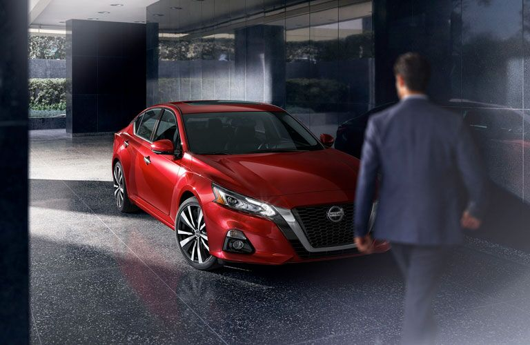 front of red 2020 Nissan Altima