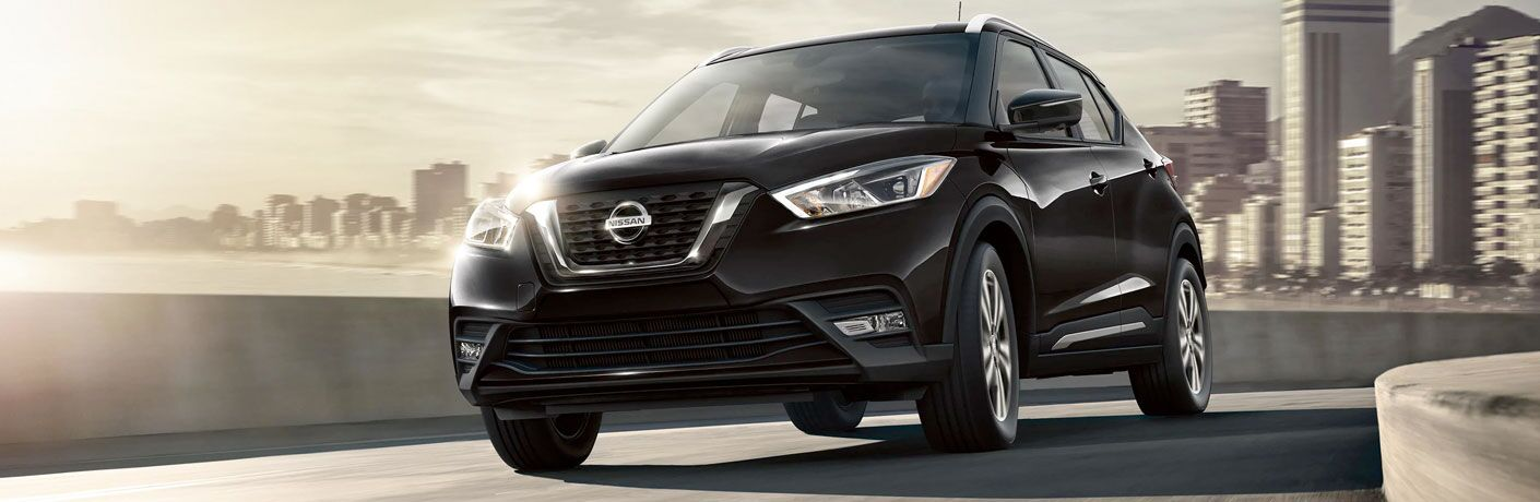 black 2020 Nissan Kicks driving through city